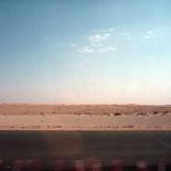 Sky, sand, road