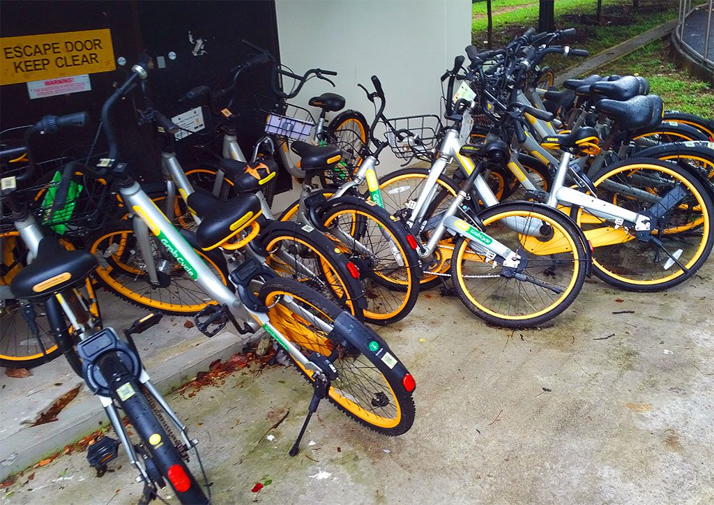 A mess of obikes in a neighborhood
