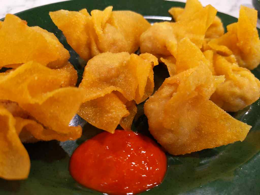 Fried wanton with their special chilli sauce