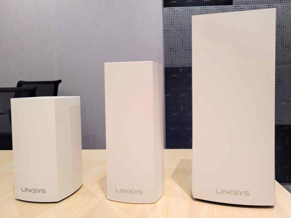 Linksys lineup of Velop routers with the Linksys MX4200 Mesh Router on the far right